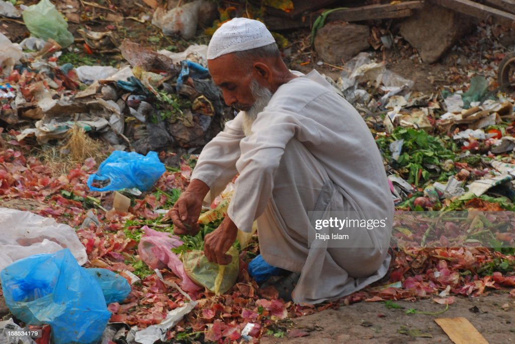A poor man colleting food items from trash here in port city Karachi.