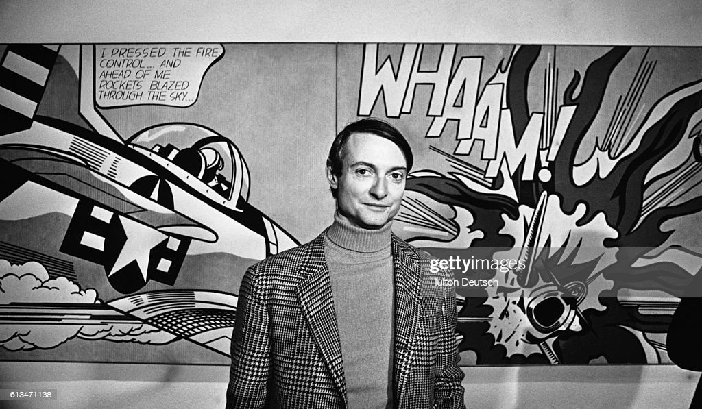 Pop Art painter Roy Lichtenstein in front of his painting Whaam! during an exhibition of his work at the Tate Gallery, London.