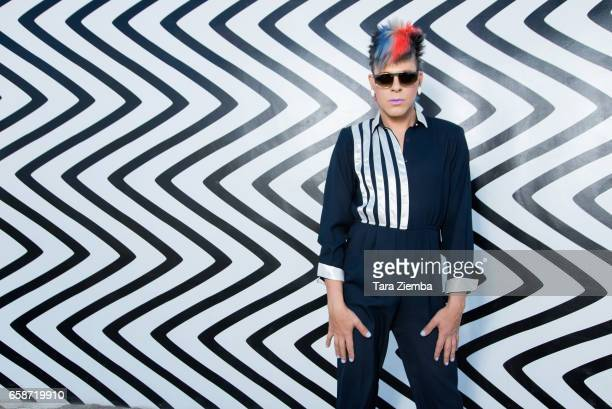 Pop artist and tv personality Sham Ibrahim visits 'Curves and Zigzags' a free standing wall by artist Claudia Comte at Desert X on March 26 2017 in...