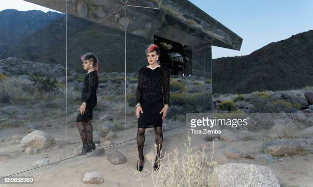 Pop artist and tv personality Sham Ibrahim visits 'Mirage' a ranchstyle structure by artist Doug Aitken at Desert X on March 26 2017 in Palm Springs...