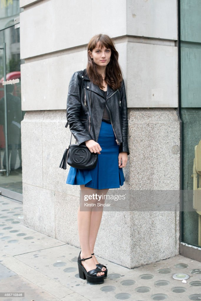 Pop Artist for Say Lou Lou Miranda Kilbey is wearing a Gucci bag and jacket, Richard Nichols skirt, Stella McCartney top and Asos shoes on day 3 of London Collections: Women on September 14, 2014 in London, England.