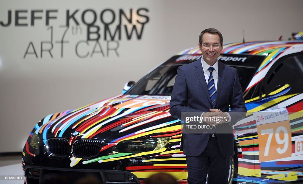 US pop artist Jeff Koons poses in front of his BMW Art Car decorated with exploding, multi-colored rays on June 2, 2010 during a press conference at the Centre Pompidou, museum for contemporary art in Paris. The garish work is number 17 in a series dating back to 1975 in which famous contemporary artists, including Andy Warhol, Roy Lichtenstein and David Hockney, have painted BMWs ahead of Le Mans 24 Hours road race.