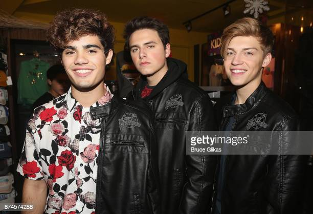 Pop band 'Forever In Your Mind' Emery Kelly Liam Attridge and Ricky Garcia pose at Planet Hollywood Times Square on November 14 2017 in New York City