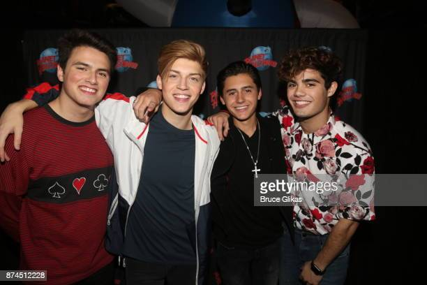 Pop band 'Forever In Your Mind' Ricky Garcia Liam Attridge Emery Kelly pose with Isaak Presley at Planet Hollywood Times Square on November 14 2017...