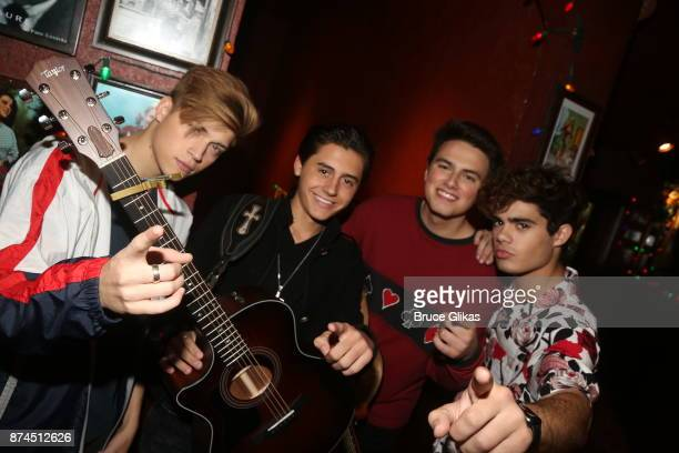 Pop band 'Forever In Your Mind' Ricky Garcia Liam Attridge Emery Kelly and Isaak Presley pose at Planet Hollywood Times Square on November 14 2017 in...