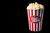 pop corn in bucket on black background