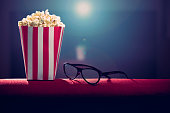 pop corn and 3d glasses on armchair cinema
