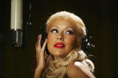 S pop diva Christina Aguilera strikes a pose during the shooting of the latest global Pepsi commercial The campaign called downloaded features...