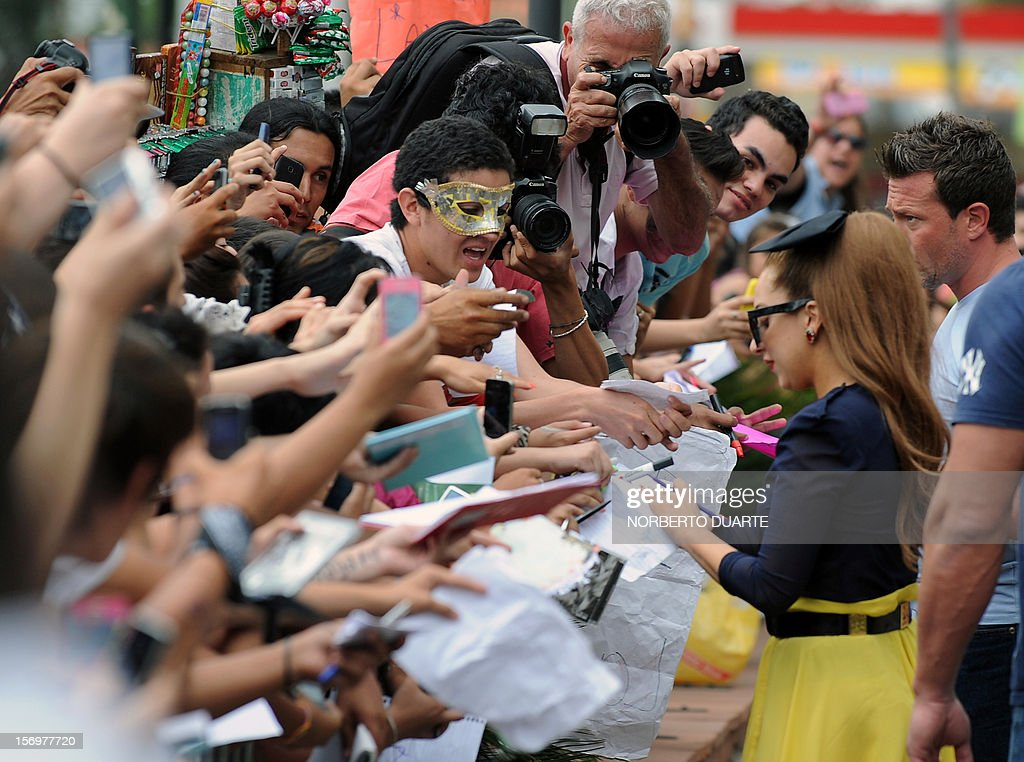US pop diva Lady Gaga (R) signs autographs to fans outside the hotel, in Asuncion, on November 26, 2012. Lady Gaga, currently on tour in South America, will offer a show tonight in the Paraguayan capital. AFP PHOTO/NORBERTO DUARTE