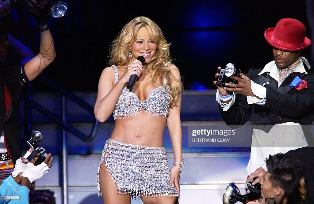 Pop diva Mariah Carey performs in Bercy in Paris 04 November 2003 during a unique concert 'Around the World' Carey is one of the bestselling female...