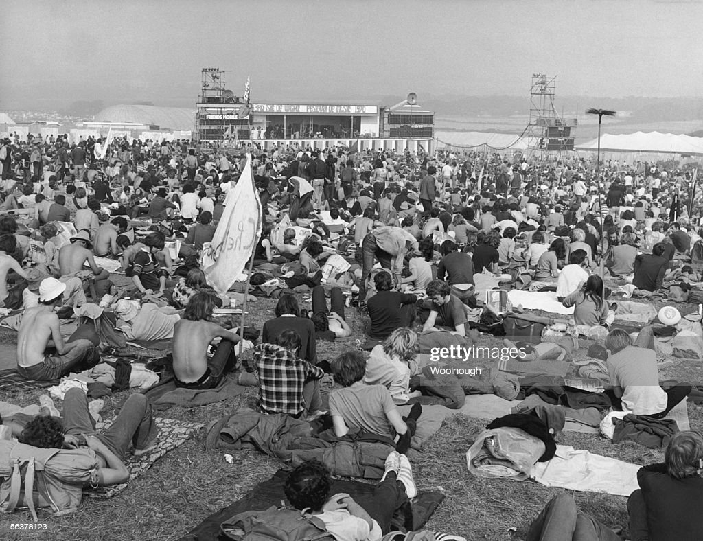 Pop fans sitting in a field at East Afton near Freshwater during the third Isle of Wight Festival 29th August 1970 It was the biggest festival of its...