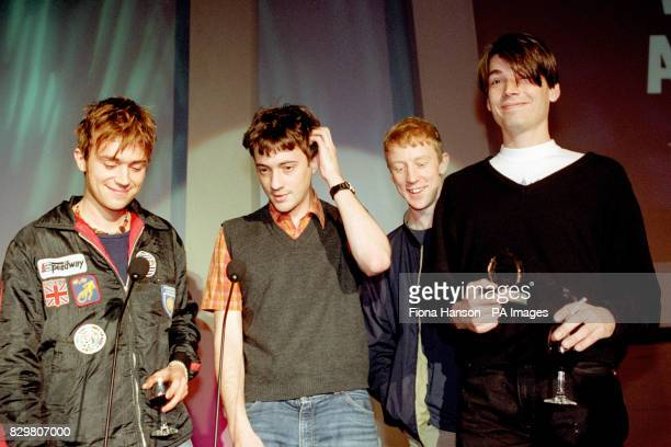 Pop group Blur accept the Q award for best album of 1994 for 'Parklife' at the music magazine's award ceremony at the Park Lane Hotel lead singer...