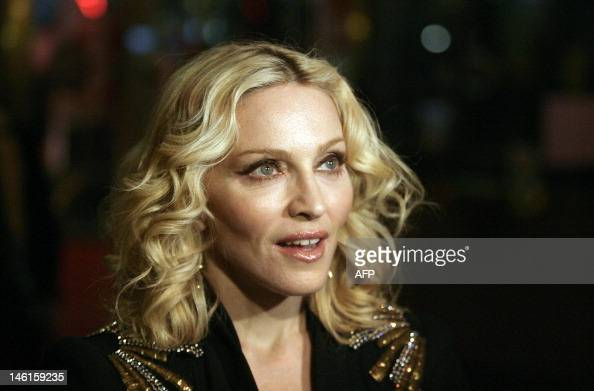 """US pop icon Madonna poses as she arrives for the premiere of the film she directed 'Filth and Wisdom"""" and presented in the 'Panorama Special'..."""