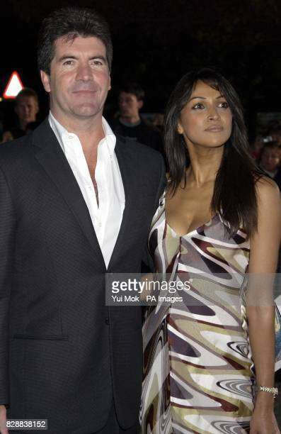 Pop Idol judge Simon Cowell and Jackie St Clair arrive for the annual National Television Awards at the Royal Albert Hall in central London