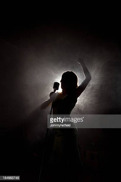 Pop idol singing and silhouetted