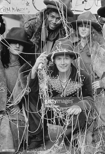 Pop impresario Malcolm McLaren and models wearing items from designer Vivienne Westwood's 'Buffalo' collection London February 1983