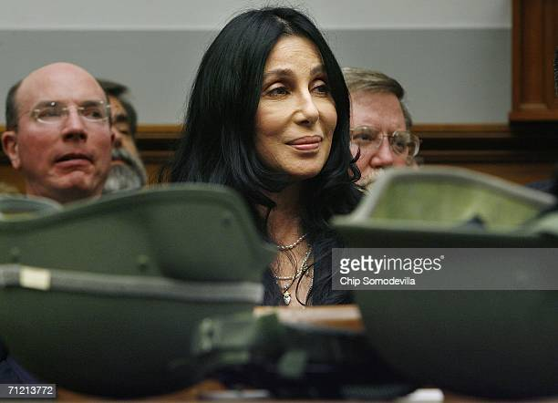Pop music star Cher listens to the testimony of retired US Navy Medical Corps Dr Bob Meaders while he appears before the US House Armed Services...