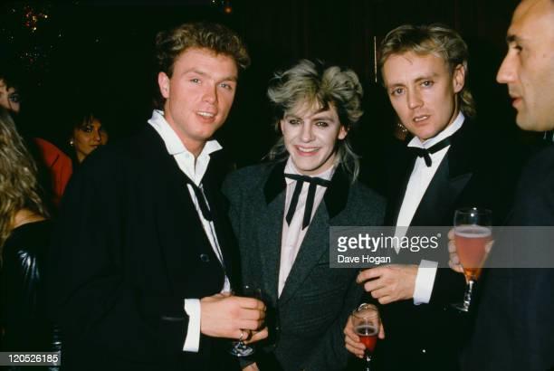 Pop musicians guitarist Gary Kemp of Spandau Ballet keyboard player Nick Rhodes of Duran Duran and drummer Roger Taylor of Queen 1985