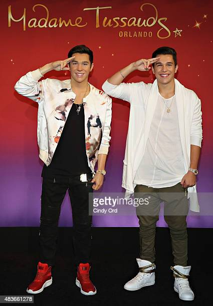 Pop Sensation Austin Mahone meets his new Madame Tussauds Orlando wax figure at Madame Tussauds New York on August 11 2015 in New York City