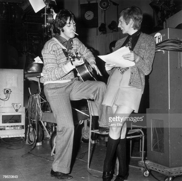 Pop singer and entertainer Cilla Black rehearses a song with Paul McCartney in a recording studio 29th January 1968 McCartney has written the song...