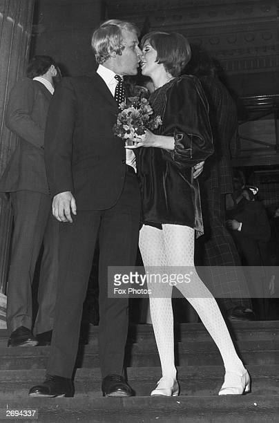 Pop singer and TV personality Cilla Black gets a kiss from her bridegroom and personal manager Bobby Willis on the steps of Marylebone Town Hall...