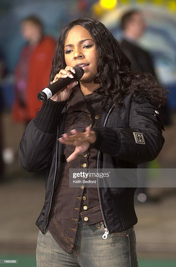 Pop singer Ashanti rehearses for her performance in the Macy's Thanksgiving Day Parade in front of the department store November 25 2002 in New York...