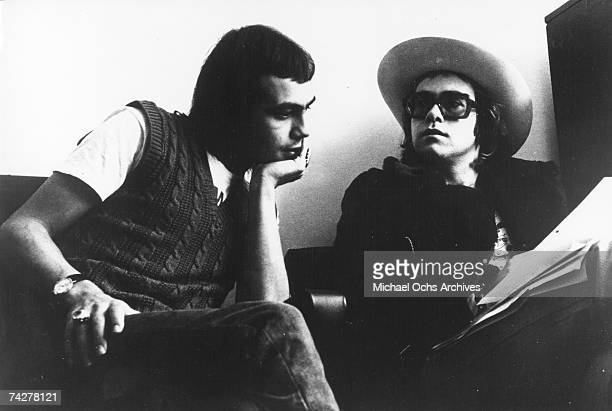 Pop singer Elton John and his lyricist Bernie Taupin pose for a portrait in circa 1973 in London England