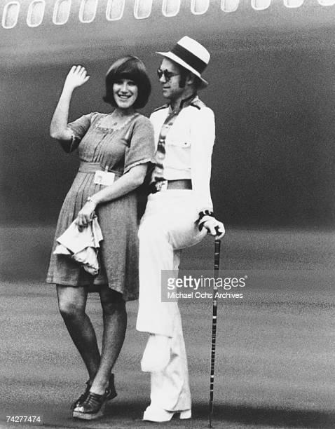 Pop singer Elton John poses for a portrait with Kiki Dee in circa 1977