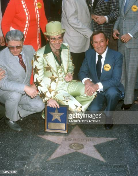 Pop singer Elton John receives a star on the Hollywood Walk of Fame on October 23 1975 in Los Angeles California