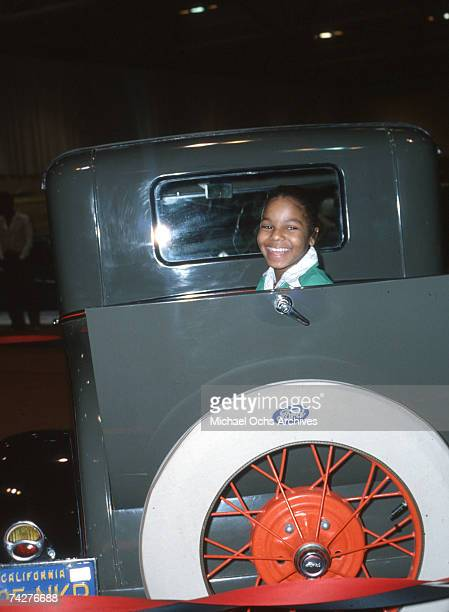 Pop singer Janet Jackson poses for a portrait session with a Model T Ford in January 1977 in Los Angeles California