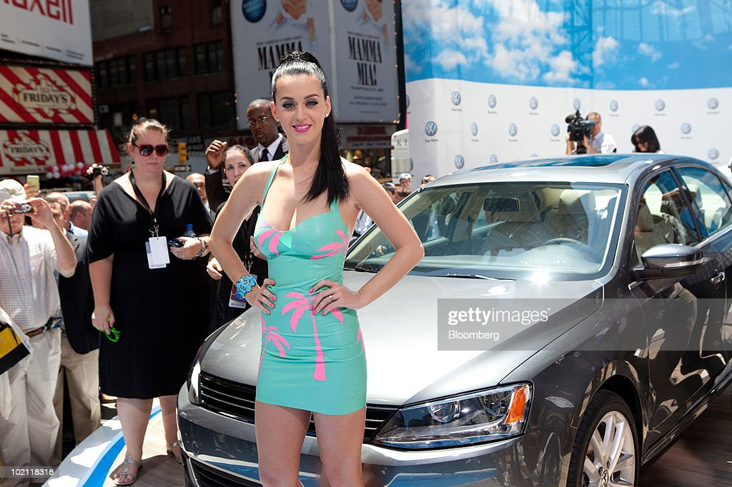 Pop singer Katy Perry poses in front of the new 2011 Volkswagen Jetta during a news conference in New York, U.S., on Tuesday, June 15, 2010. Volkswagen AG plans to cut the U.S. price and increase the size of the Jetta compact car, its best-selling model in the country, as the automaker seeks to almost double sales in the market by 2012. Photographer: JB Reed/Bloomberg via Getty Images