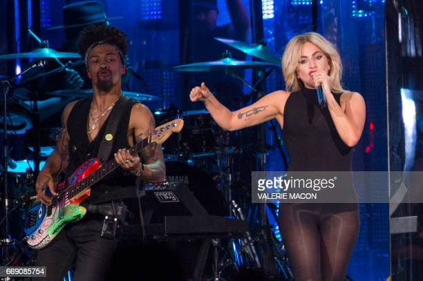 US pop singer Lady Gaga performs on stage at the Coachella Valley Music And Arts Festival on April 15 2017 in Indio California / AFP PHOTO / VALERIE...