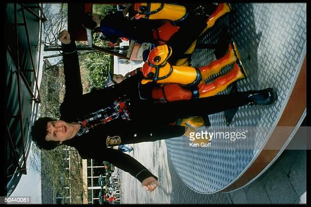 Pop singer Les McKeown formerly of Scottish band the Bay City Rollers riding on merrygoround at zoo