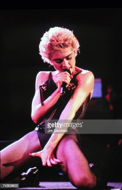 Pop singer Madonna performs onstage in a black bustier in 1988 in St Paul Minnesota