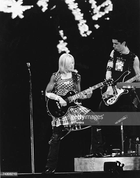 Pop singer Madonna plays a Gibson Les Paul electric guitar as she performs onstage on August 2 2001 in New Jersey