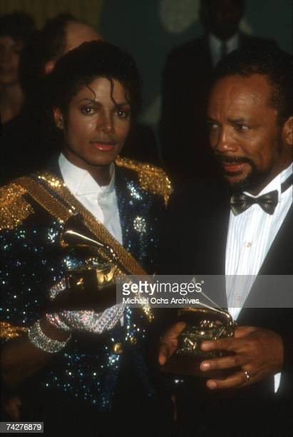Pop singer Michael Jackson and producer Quincy Jones pose for a portrait after winning at the Grammys for their work on the album Thriller on...