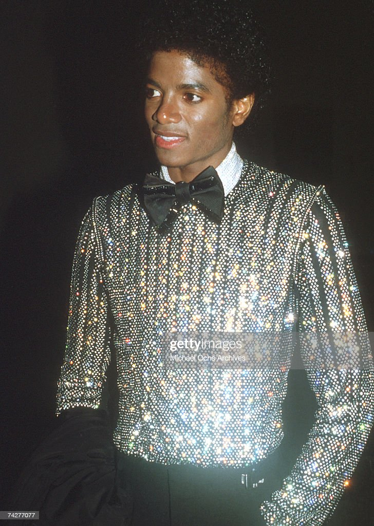 Pop singer Michael Jackson attends an event wearing a sequined shirt and a bow tie in 1979