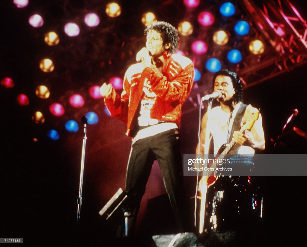 Pop singer <a gi-track='captionPersonalityLinkClicked' href=/galleries/search?phrase=Michael+Jackson&family=editorial&specificpeople=70011 ng-click='$event.stopPropagation()'>Michael Jackson</a> of the R&B quintet 'Jackson 5' performs onstage during the 'Victory Tour' with his brother Jermaine Jackson playing bass in December 1984 in Los Angeles, California.