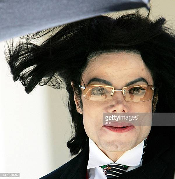 Pop Singer Michael Jackson's hair flies in the wind as he departs the Santa Barbara County courthouse 29 April in Santa Maria California as court is...