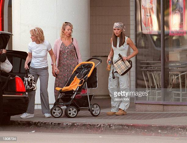 Pop Singer Victoria Adams 'Posh Spice' along with her mother Jackie Adams get help loading the limo with their packages October 12 2000 in Los...