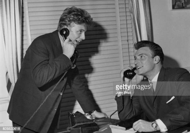 Pop singers Tommy Steele and Frank Ifield on the phone November 1959