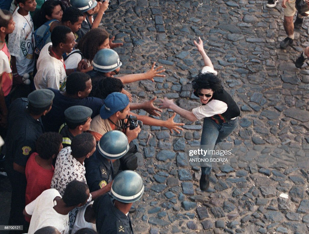 US pop star and entertainer <a gi-track='captionPersonalityLinkClicked' href=/galleries/search?phrase=Michael+Jackson&family=editorial&specificpeople=70011 ng-click='$event.stopPropagation()'>Michael Jackson</a> during the filming of his video 'They don't care about us' Febuary 10, 1996, in salvador. <a gi-track='captionPersonalityLinkClicked' href=/galleries/search?phrase=Michael+Jackson&family=editorial&specificpeople=70011 ng-click='$event.stopPropagation()'>Michael Jackson</a> died on June 25, 2009 after suffering a cardiac arrest, sending shockwaves sweeping across the world and tributes pouring in on June 26 for the tortured music icon revered as the 'King of Pop.' AFP PHOTO/Antonio SCORZA