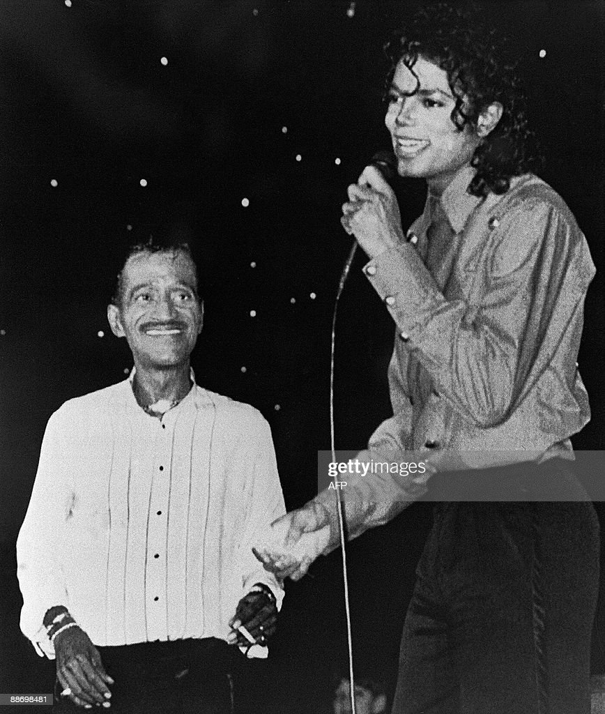 US pop star and entertainer <a gi-track='captionPersonalityLinkClicked' href=/galleries/search?phrase=Michael+Jackson&family=editorial&specificpeople=70011 ng-click='$event.stopPropagation()'>Michael Jackson</a> performs with Sammy Davis Junior August 14, 1988 in Monaco. <a gi-track='captionPersonalityLinkClicked' href=/galleries/search?phrase=Michael+Jackson&family=editorial&specificpeople=70011 ng-click='$event.stopPropagation()'>Michael Jackson</a> died on June 25, 2009 after suffering a cardiac arrest, sending shockwaves sweeping across the world and tributes pouring in on June 26 for the tortured music icon revered as the 'King of Pop.'