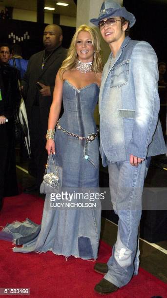 Pop star Britney Spears and her boyfriend singer Justin Timberlake of the group NSYNC arrive backstage at the 28th Annual American Music Awards 08...
