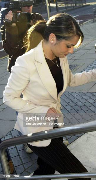 Pop star Cheryl Tweedy of Girls Aloud arrives at Kingston Crown Court where she is accused of punching and racially abusing a nightclub toilet...