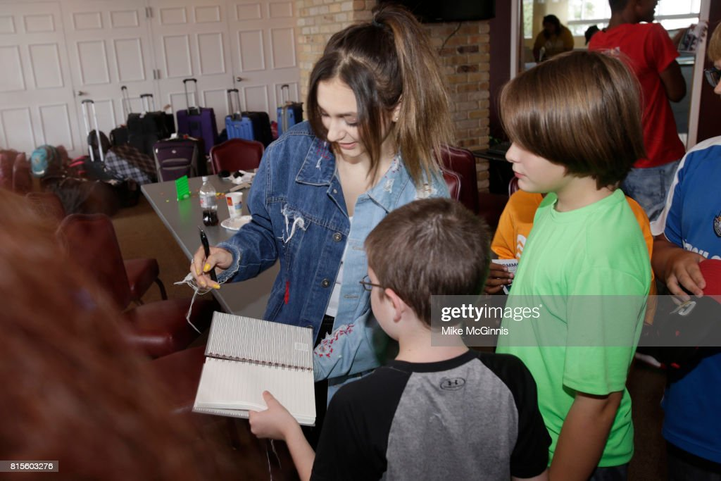 Pop Star Daya surprises kids of Camp Hometown Heroes, summer camp for children of Fallen U.S. Service Members at General Mitchell Airport on July 16, 2017 in Milwaukee, Wisconsin.