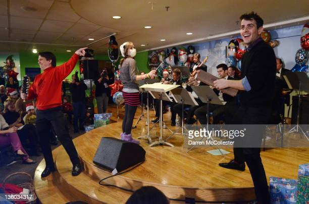 Pop star Joey McIntyre joins conductor Keith Lockhart and patient Sierra during a concert with The Boston Pops at Children's Hospital Boston on...