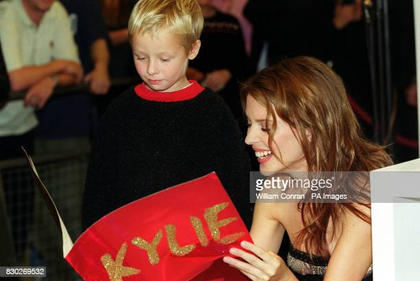 Pop star Kylie Minogue at Selfridges department store London at the signing of her book launch 'Kylie' With her is Daniel Hughes of Sheffield who...