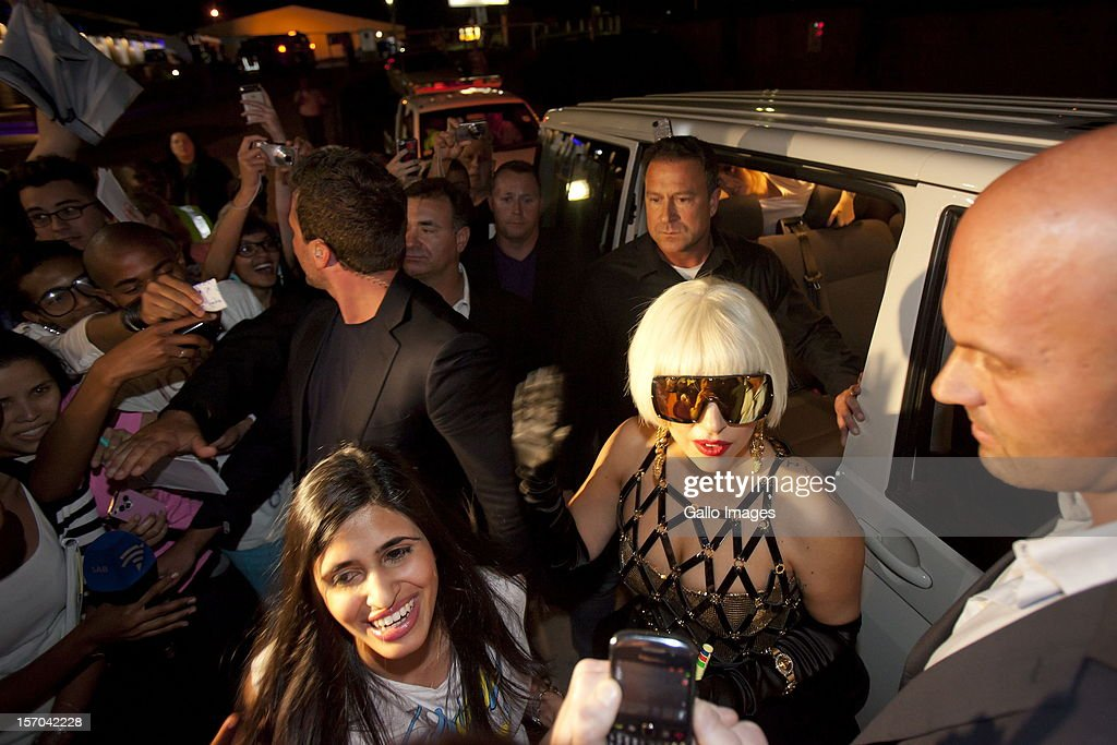 US pop star <a gi-track='captionPersonalityLinkClicked' href=/galleries/search?phrase=Lady+Gaga&family=editorial&specificpeople=4456754 ng-click='$event.stopPropagation()'>Lady Gaga</a> greets throngs of fans on arrival at the Lanseria Airport on November 27, 2012 in Johannesburg, South Africa. Gaga will be performing in South Africa as part of her 'Born This Way Ball' tour.