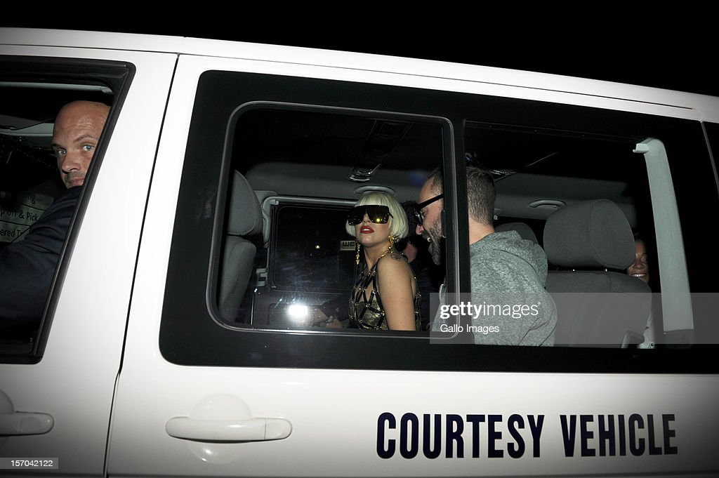 US pop star Lady Gaga is driven away in a courtesy vehicle after arriving at the Lanseria Airport on November 27, 2012 in Johannesburg, South Africa.